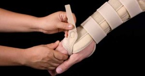 Hand being fitted for carpal tunnel syndrome splint