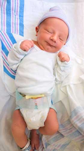 Newborn in hospital incubator