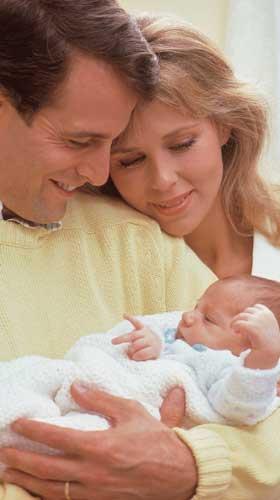 Parents holding newborn
