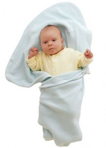Baby swaddled in blanket